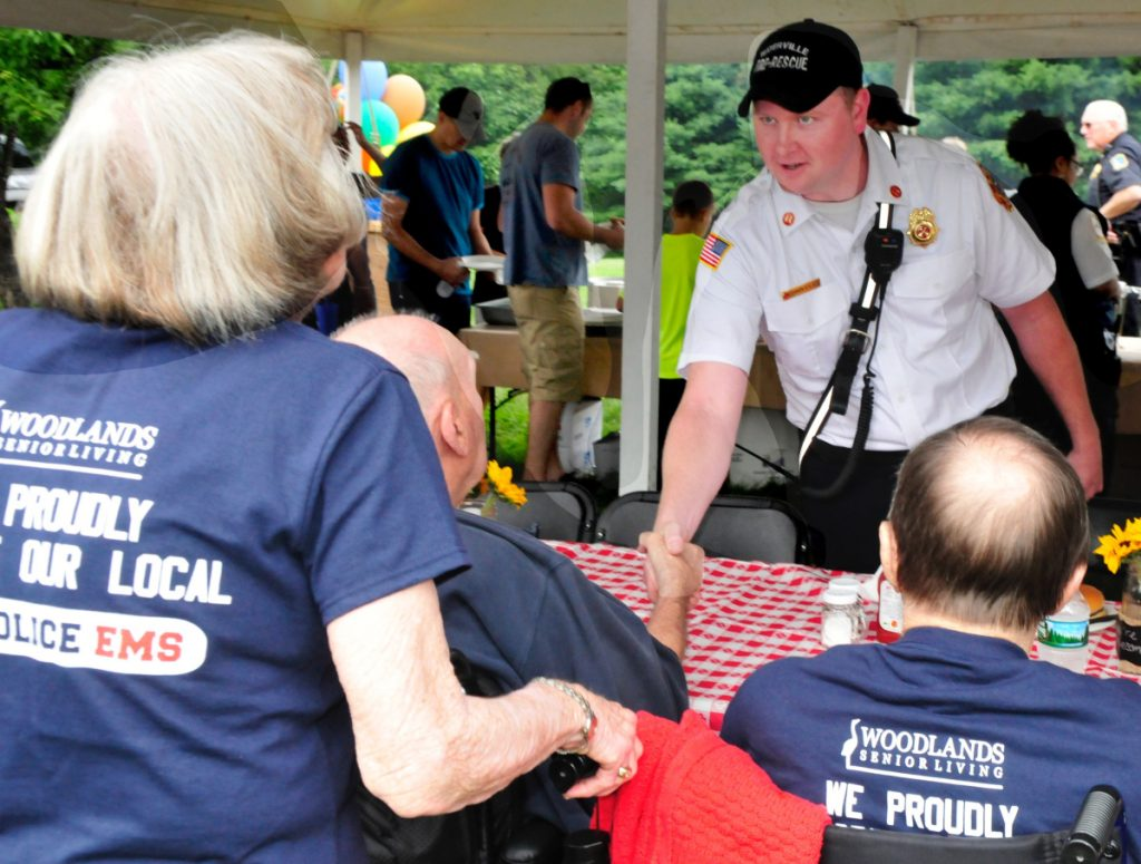 A Winslow committee has decided not to employ newly named Waterville Fire Chief Shawn Esler as the town's chief, according to a message Mike Roy received from Winslow Town Manager Michael Heavener. Pictured here, Esler socializes with Woodlands Senior Living residents during the 2nd annual Appreciation gathering at the Waterville facility on July 28, 2017.