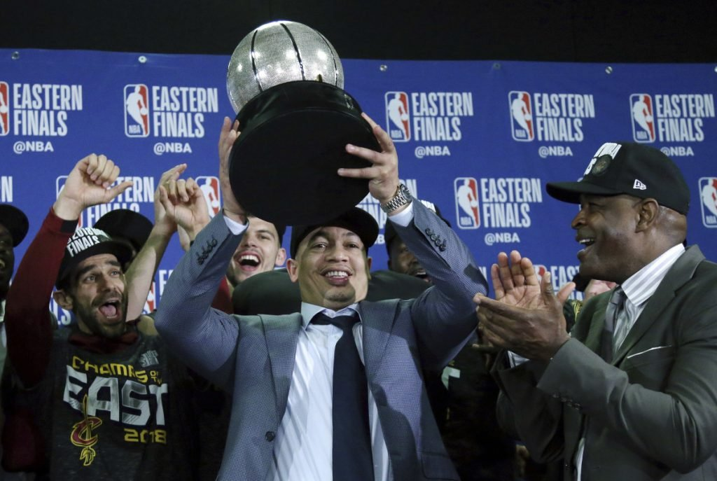 Cleveland Cavaliers head coach Tyronn Lue hoists the trophy after beating the Boston Celtics 87-79 in Game 7 of the Eastern Conference Finals on Sunday in Boston.