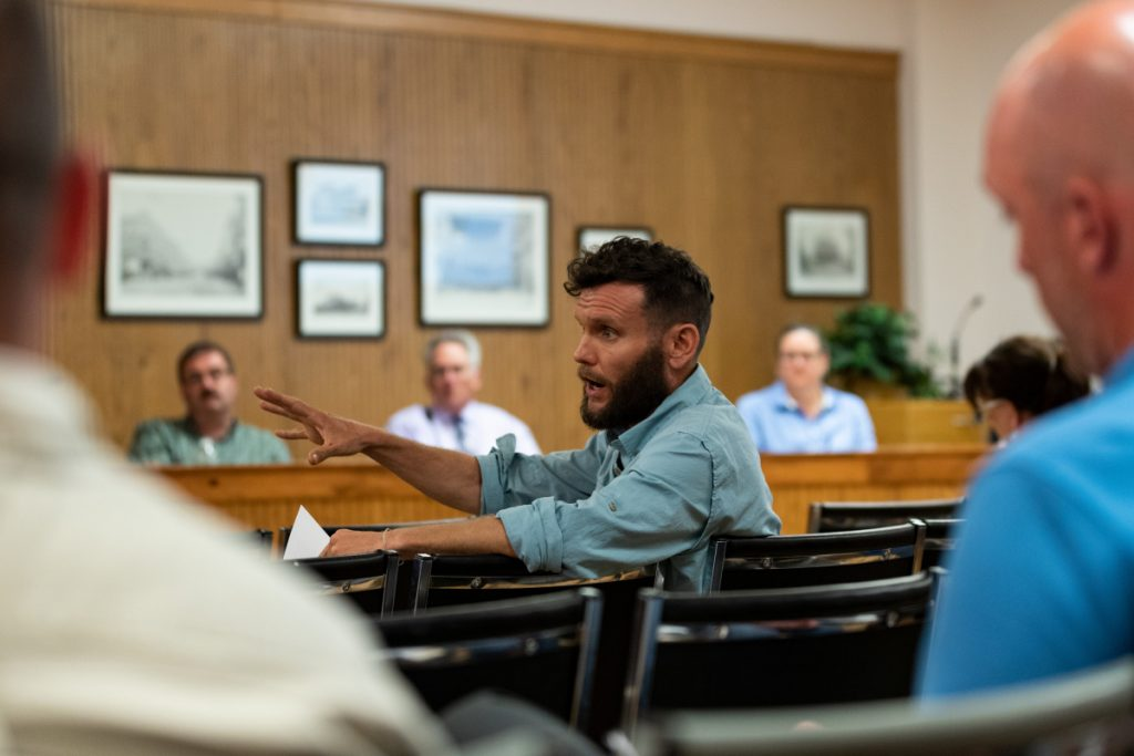 Ward 3 resident Thomas Klepach asks a question of City Manager Mike Roy during the City Council budget meeting Tuesday. Klepach asked questions about the airport budget as well as other line items.