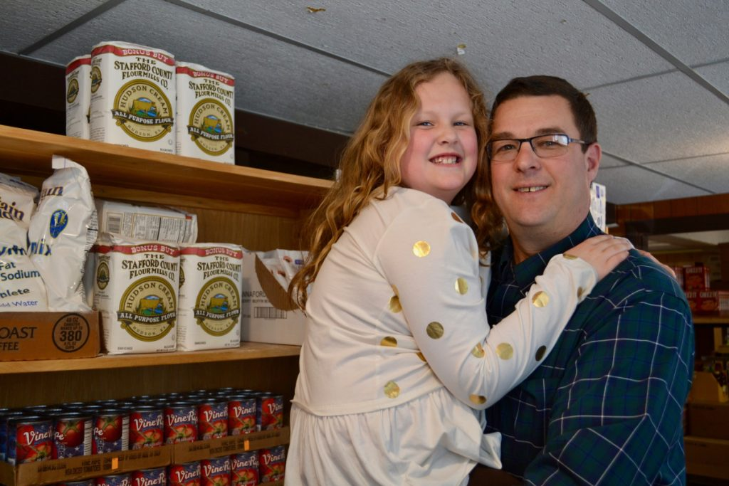 Chris Russell, right, and his daughter Gabby recently toured the Winthrop Food Pantry, a United Way partner program.
