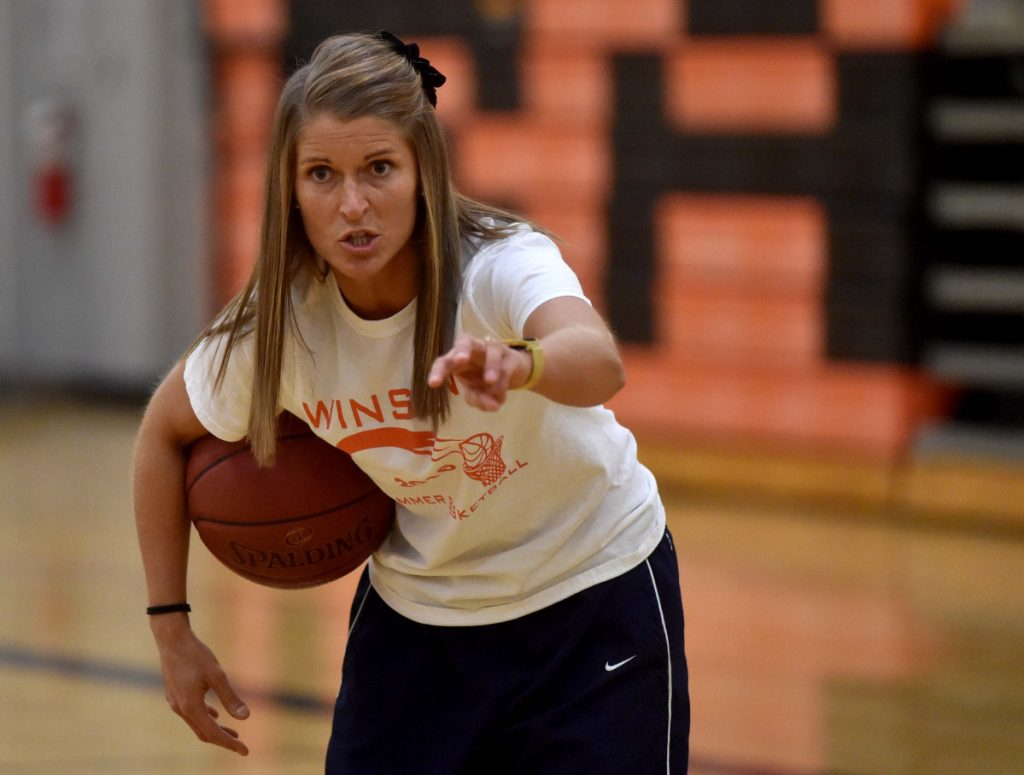 Lindsey Withee, head basketball coach at Winslow High School, works out her players during girls basketball practice at Winslow High School in November of 2016. Withee resigned from her post Wednesday.
