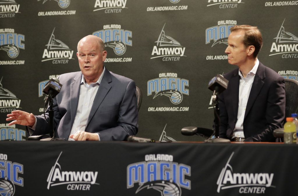 Orlando Magic President of Basketball Operations Jeff Weltman, right, listens as the teams new head coach Steve Clifford answers questions at a news conference Wednesday in Orlando, Florida.