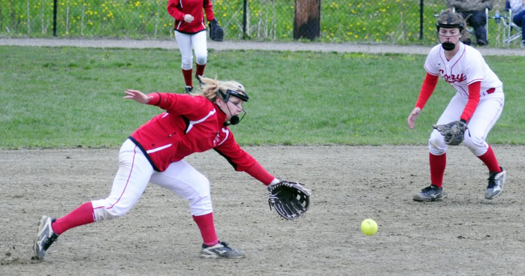 Cony third baseman Alexis Couverette, left, and shortstop Carly Lettre chase a bouncing ball in the infield during a Kennebec Valley Athletic Conference Class A game last season at Cony Family Field in Augusta.
