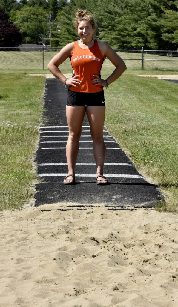 Skowhegan's Leah Savage stands where the triple jump runway and pit meet at the high school on Wednesday. Savage is a contender for the Class A triple jump title.
