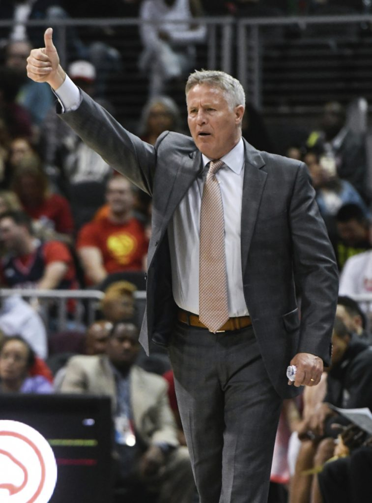 Philadelphia 76ers coach Brett Brown signals players during the second half of a game against the Atlanta Hawks back in April in Atlanta. Brown, a Maine native and son of legendary coach Bob Brown, was given a 3-year extension by the 76ers on Thursday.