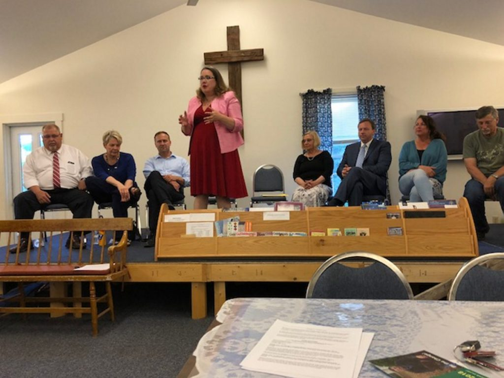 Gubernatorial candidate Diane Russell speaks to about 50 people who turned out Wednesday night for a candidates forum at South China Community Church. Seated behind her are, from left, gubernatorial candidates Mark Dion, Elizabeth Sweet, and Adam Cote; China resident Dawn Castner, who is running for state House District 79; gubernatorial candidate Mark Eves; and Kellie Julia and John Glowa, who are running for Senate District 15.