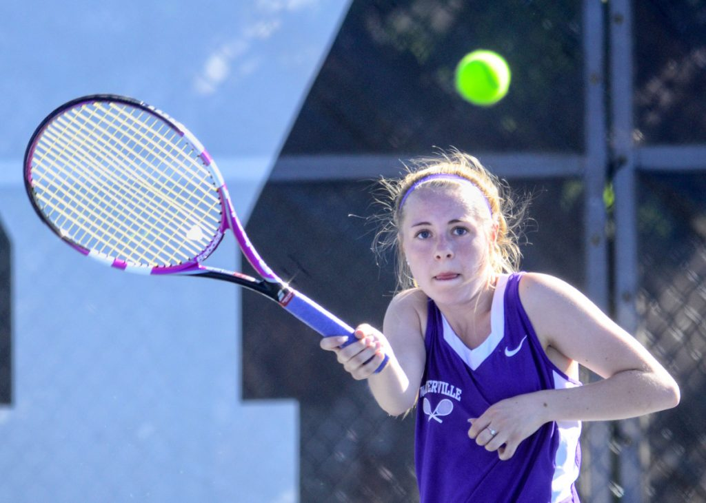 Waterville second singles player Maggie Brock returns a shot during a Class B North quarterfinal match against Erskine on Thursday at Colby College.