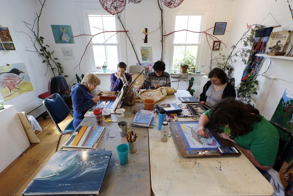 A group of artists and a mentor are hard at work at Spindleworks, an art studio for people with intellectual disabilities. The studio is an example of a service whose funding has suffered from the Legislature's adjournment that left important business unfinished. Clockwise from left: Grace McKenna, artist mentor Julianne Carle, Lidia Woofenden, McKensy Brown and Barbara Welborn.