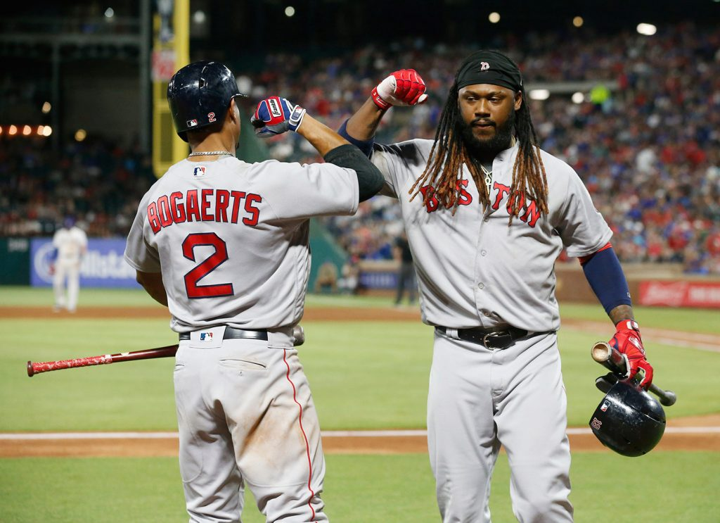 Boston Red Sox's Xander Bogaerts congratulates Hanley Ramirez, right, after Ramirez drove in the winning run against the Texas Rangers during the ninth inning Saturday in Arlington, Texas.