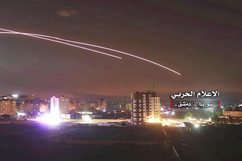 Israeli missiles target air defense positions and other military bases in Damascus, Syria, Thursday in response to an Iranian rocket barrage on Israeli positions in the Golan Heights.