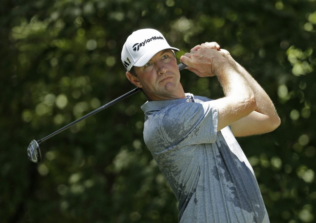 In this Aug. 20, 2016, photo, Lucas Glover plays in the Wyndham Championship golf tournament in Greensboro, N.C.