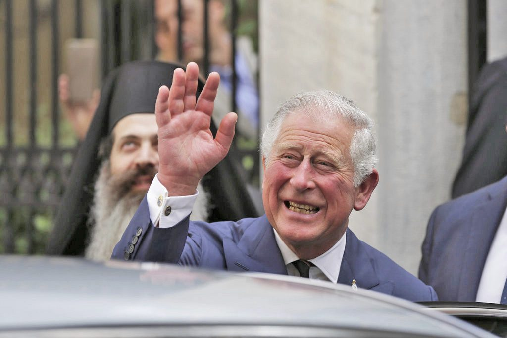 "Britain's Prince Charles leaves a meeting with the head of Greece's Orthodox Church, Archbishop Ieronymos, in Athens, on May 10, 2018.  ""Pleased to be able to welcome Ms. Markle to the Royal Family in this way."""