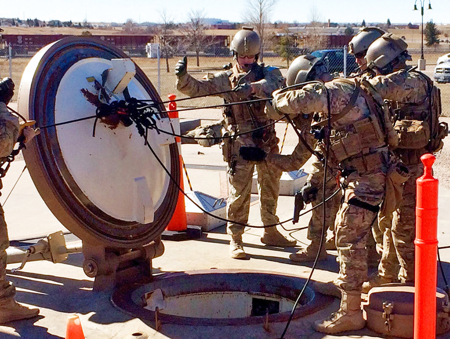 In this February 2016 photo, members of the 790th Missile Security Forces Squadron show their training for recapturing a Minuteman missile silo from an intruder. The demonstration took place just days before the Air Force announced the drug investigation, at the Francis E. Warren Air Force Base, near Cheyenne, Wyo.