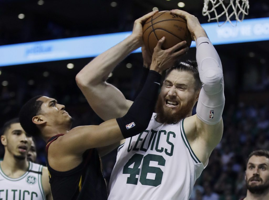 Boston's Aron Baynes battles for a rebound with Cleveland's Jordan Clarkson Wednesday night in Game 5 of the Eastern Conference finals.