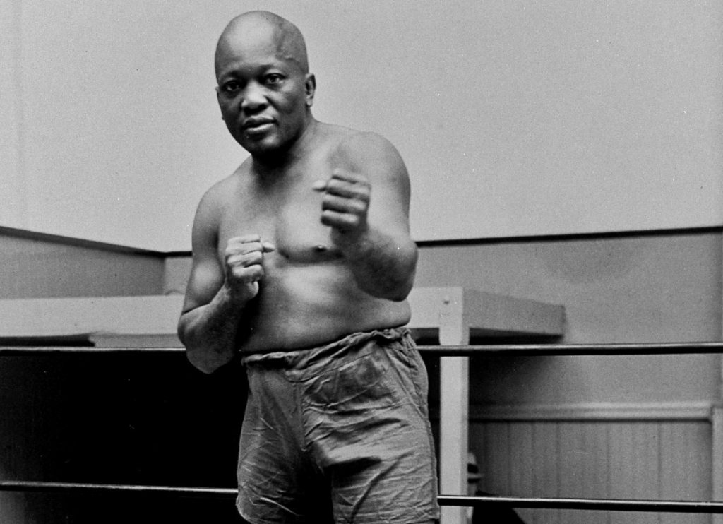 Boxer Jack Johnson, the first black world heavyweight champion, poses for a photo in 1932 in New York City. President Donald Trump on Thursday granted a rare posthumous pardon to boxing's first black heavyweight champion, clearing Jack Johnson's name more than 100 years after a racially charged conviction.