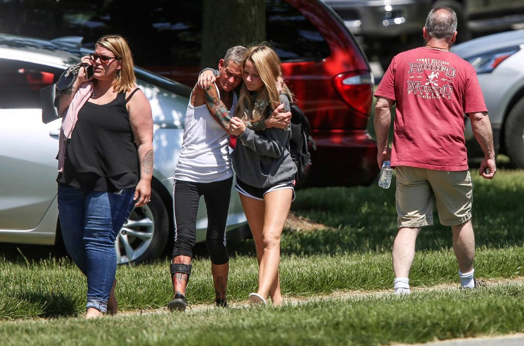 People react to Friday's shooting in Noblesville, Ind., in which a middle school student opened fire, wounding a student and a teacher before being taken into custody, authorities said.