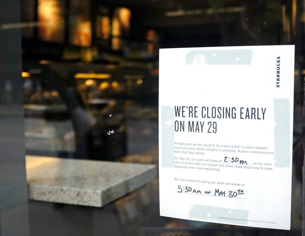 A store closing sign is posted outside of a Starbucks store. Starbucks will close more than 8,000 stores nationwide Tuesday to conduct anti-bias training.   Kiichiro Sato/Associated Press