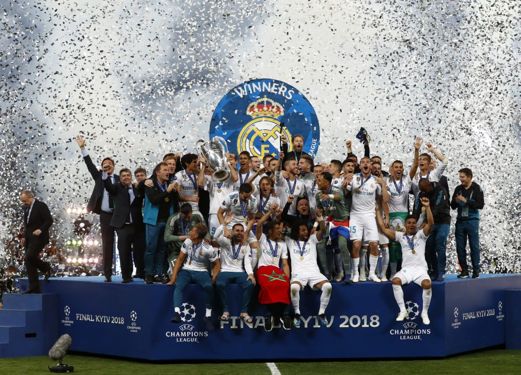 Real Madrid players celebrate with the trophy after winning the Champions League Final soccer match between Real Madrid and Liverpool on Saturday at the Olimpiyskiy Stadium in Kiev, Ukraine.