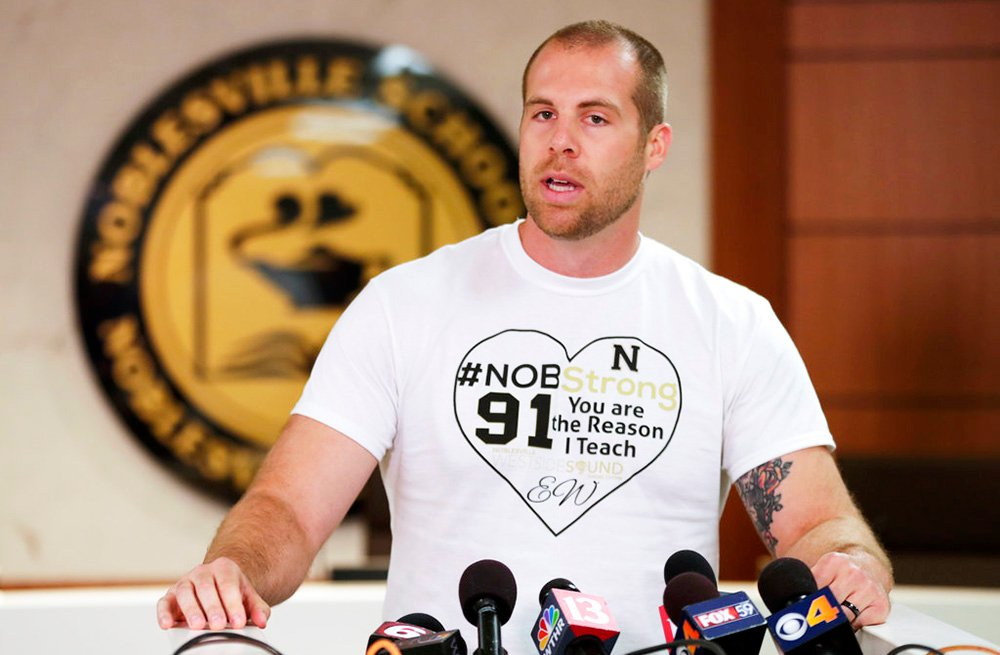 "At Monday's news conference, Jason Seaman wore a T-shirt with the message: ""#NOB Strong. You are the reason I teach,"" along with the initials of a wounded student, EW."