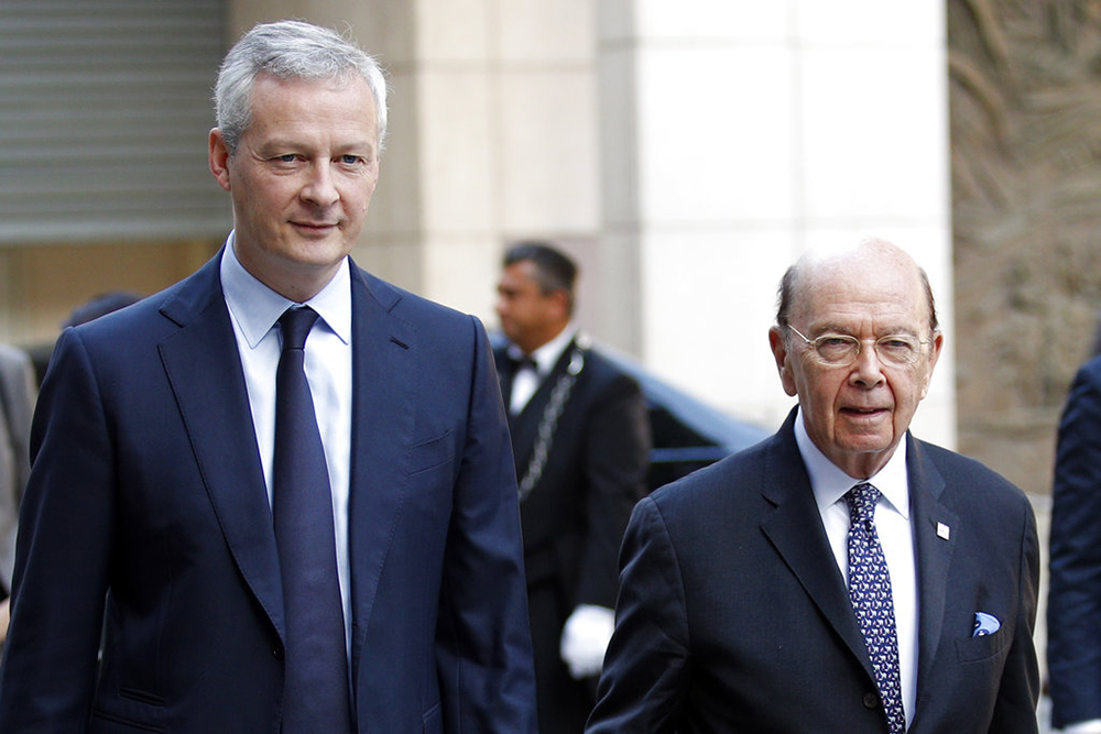 French Finance Minister Bruno Le Maire, left, welcomes U.S. Secretary of Commerce Wilbur Ross to their meeting at the French Economy Ministry in Paris on Thursday.