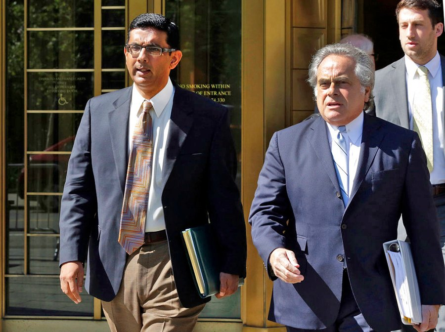 Conservative commentator and filmmaker Dinesh D'Souza, left, is accompanied by his lawyer Benjamin Brafman as they leave federal court in New York on May 20, 2014.