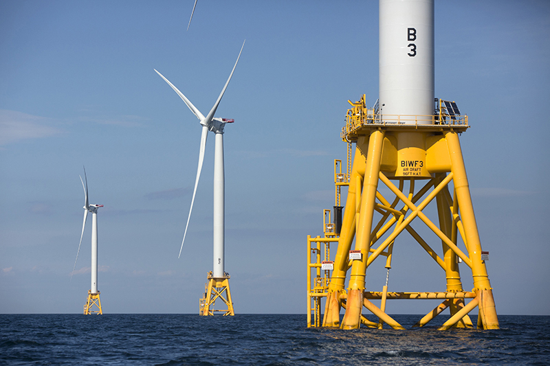 Three of Deepwater Wind's turbines stand in the water off Block Island, R.I. in 2016.