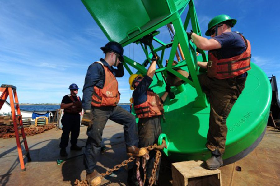 Members of Coast Guard Cutter Willow's buoy deck crew work to install the clappers on a bell buoy before the buoy is set in the water near Block Island, R.I., in 2015. The bell in the buoy is similar to the brass items targeted by thieves.
