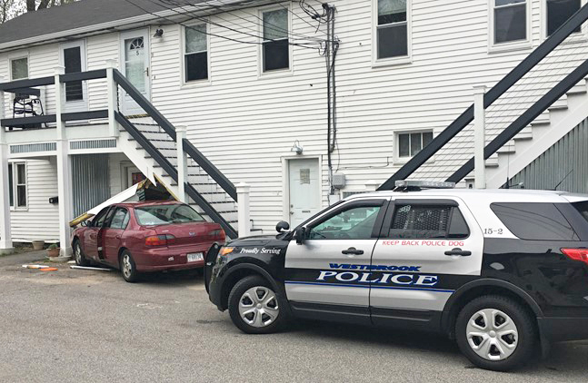 The scene where a stolen car crashed into a building at  9 Giles St. in Westbrook.