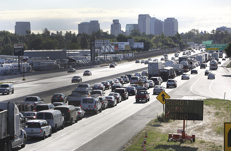 FILE - In this April 22, 2014 file photo, drivers enter Sacramento on Highway 50 to come to a near stand still as traffic backs up in West Sacramento, Calif. California and 16 other states sued the Trump administration on Tuesday, May 1, 2018, over its plans to scrap standards on vehicle greenhouse gas emissions, which help set gas mileage rules.(AP Photo/Rich Pedroncelli, File)