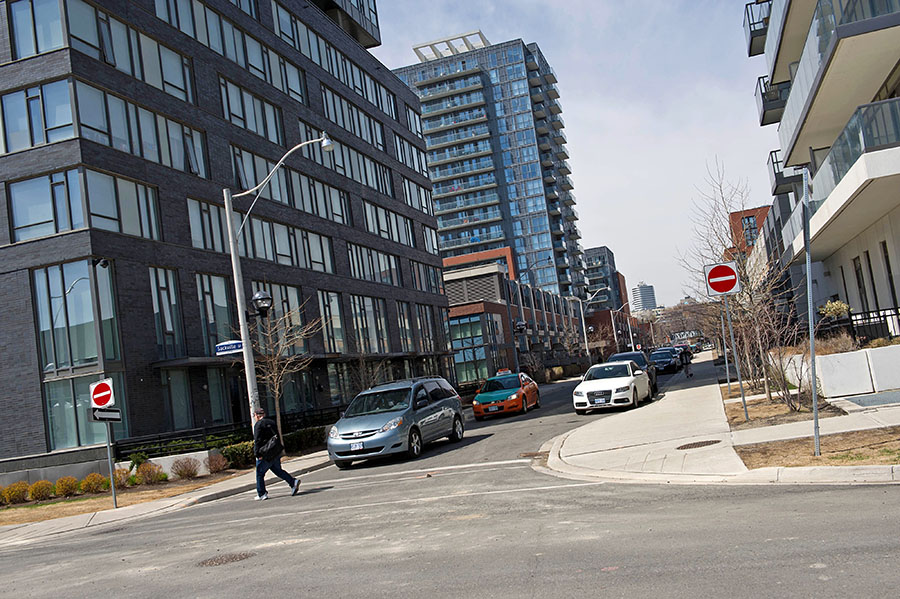 Condominiums are seen along Sackville Street at the Regent Park housing project in Toronto. The average annual income needed to purchase an average-priced resale condo in the city is about $77,000 (U.S.), up from $60,000 a year earlier, according to Urbanation Inc. In the rental market, average monthly rents surged about 11 percent in the first quarter, to $1,751.