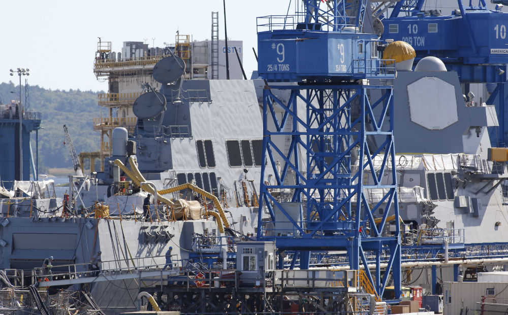 Two Arleigh Burke-class destroyers were tied up at Bath Iron Works' pier in the latter stages of construction in 2016. The yard has won a contract worth $49.8 million initially.