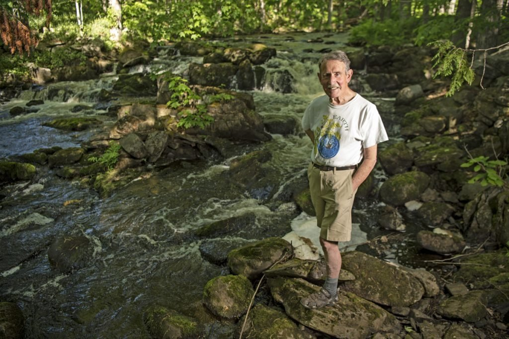 Peter Garrett at Pattee Pond Brook, near his Winslow home.
