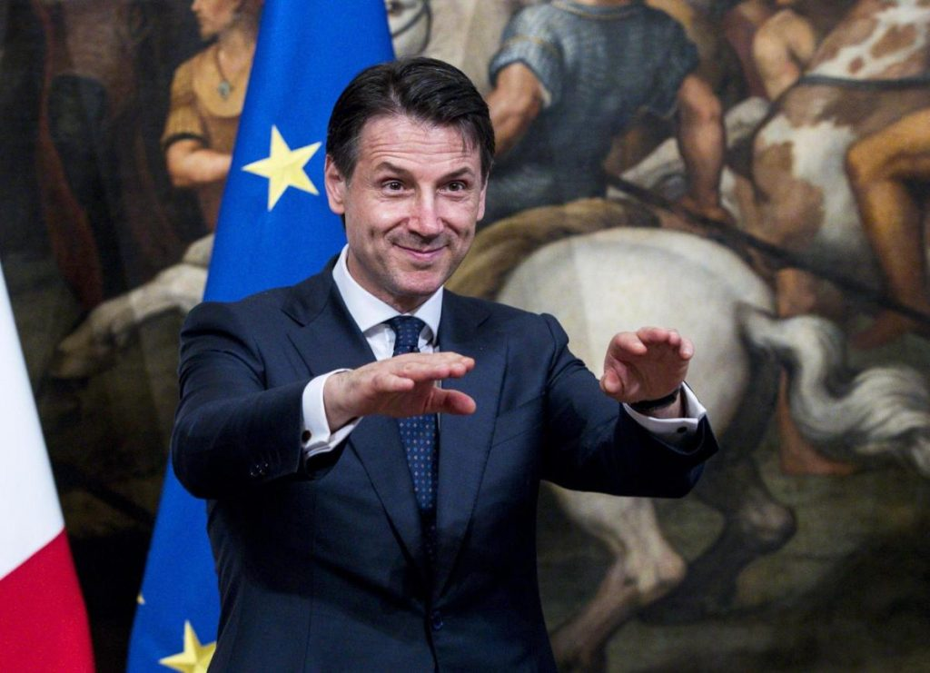 Italy's new premier, Giuseppe Conte, gestures during the handover ceremony at Chigi Palace in Rome on Friday.