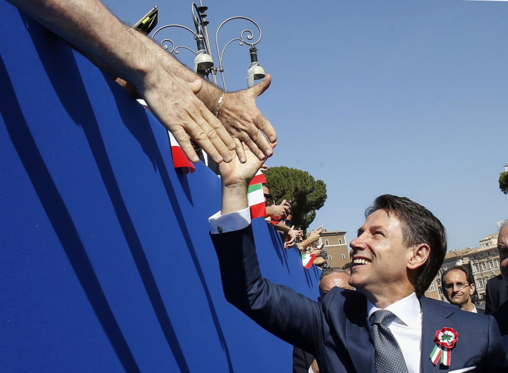 Italian Premier Giuseppe Conte is cheered by citizens during the country's Republic Day in Rome on Saturday. National pride was on display after Italy ended three months of political turmoil and swore in officials whose euro-skeptic and populist leanings have alarmed Europe.