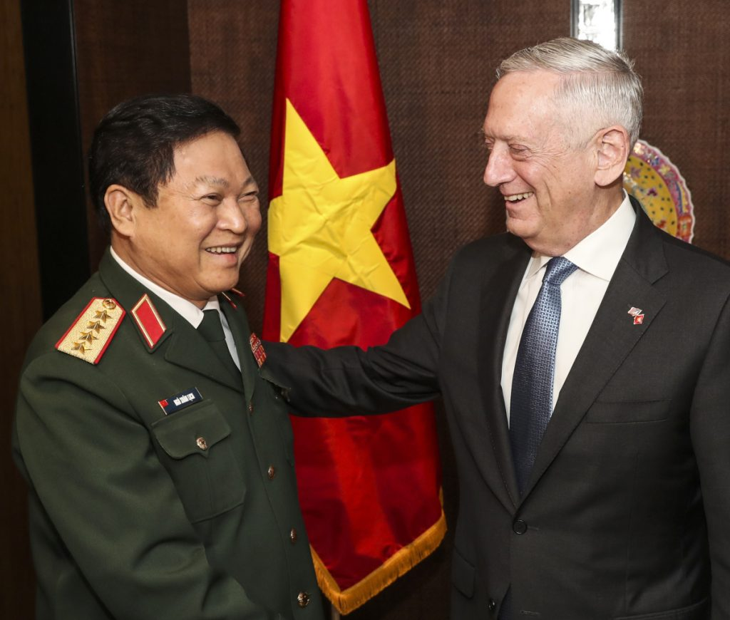 Defense Secretary Jim Mattis meets with Vietnam's Defense Minister Ngo Xuan Lich before their bilateral meeting at the Shangri-la Dialogue.