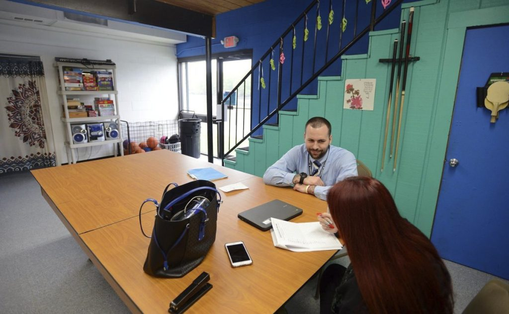 Craig Macarelli, director of Peabody Community High School, works with a student at the McPherson Youth Center in Peabody. Districts in Gloucester, Peabody, Beverly and Ipswich will offer students a chance to attend a support program instead of serving a suspension.