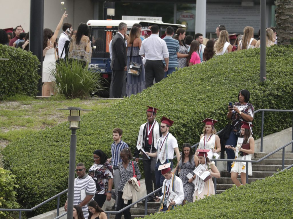 People leave a graduation ceremony for Marjory Stoneman Douglas seniors Sunday in Sunrise, Fla. The class from the high school where a gunman killed 17 people in February heard from surprise commencement speaker Jimmy Fallon, who urged the graduates to move forward.