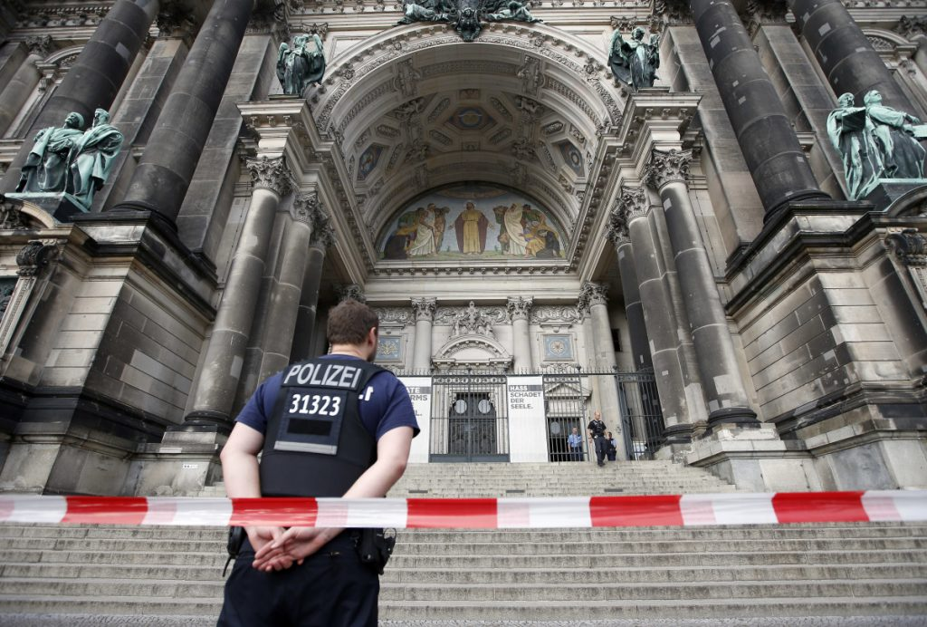 A police officer stands in front of the Berlin Cathedral in Berlin, Germany, on Sunday.