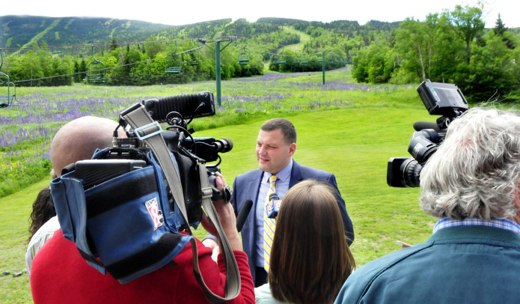 Sebastian Monsour of the Majella Group speaks with Saddleback Mountain in the background after the company agreed to purchase the ski resort in 2017.