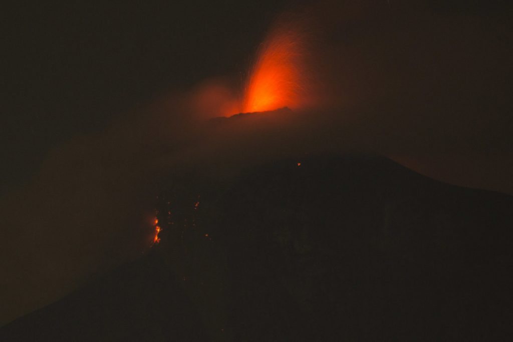 The Volcan de Fuego, or Volcano of Fire, spews molten rock from its crater in Alotenango, Guatemala on Sunday. Rescuers struggled to reach rural residents cut off by the deadly volcanic eruption.