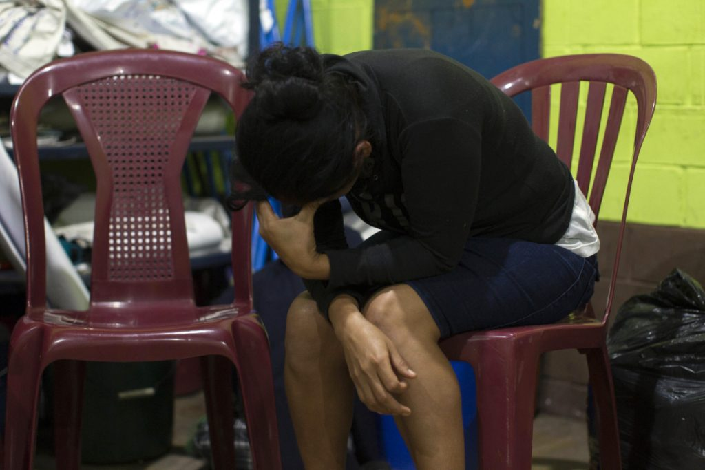 Fidelina Lopez cries for her missing relatives at a shelter in Alotenango, Guatemala. One of Central America's most active volcanos erupted in fiery explosions of ash and molten rock Sunday, killing at least 25 people and injuring multiple others while a towering cloud of smoke blanketed nearby villages in heavy ash.