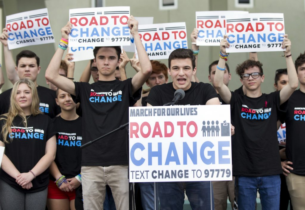 """Cameron Kasky, center, said Monday in Parkland, Fla., that the """"Road to Change"""" group will focus on getting the 4 million people turning 18 this year to vote with gun limits in mind."""