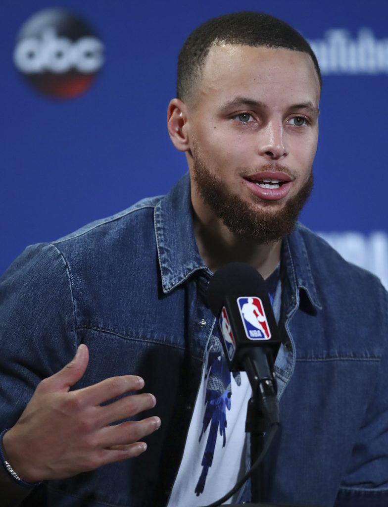 Golden State Warriors guard Stephen Curry speaks at a news conference Sunday in Oakland. On Tuesday, Curry and LeBron James were among those speaking out at the NBA Finals in support of the Philadelphia Eagles, whose scheduled visit to the White House on Tuesday was canceled by President Trump.