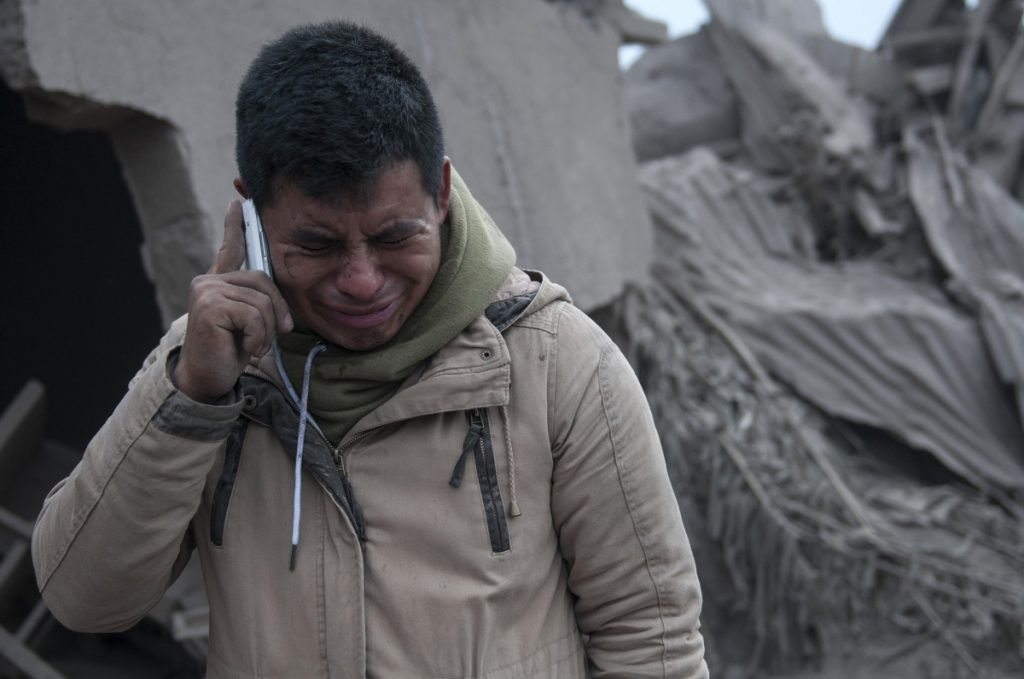 Boris Rodriguez, 24, who is searching for his wife, cries after seeing the condition of his neighborhood, destroyed by the super-heated muck.