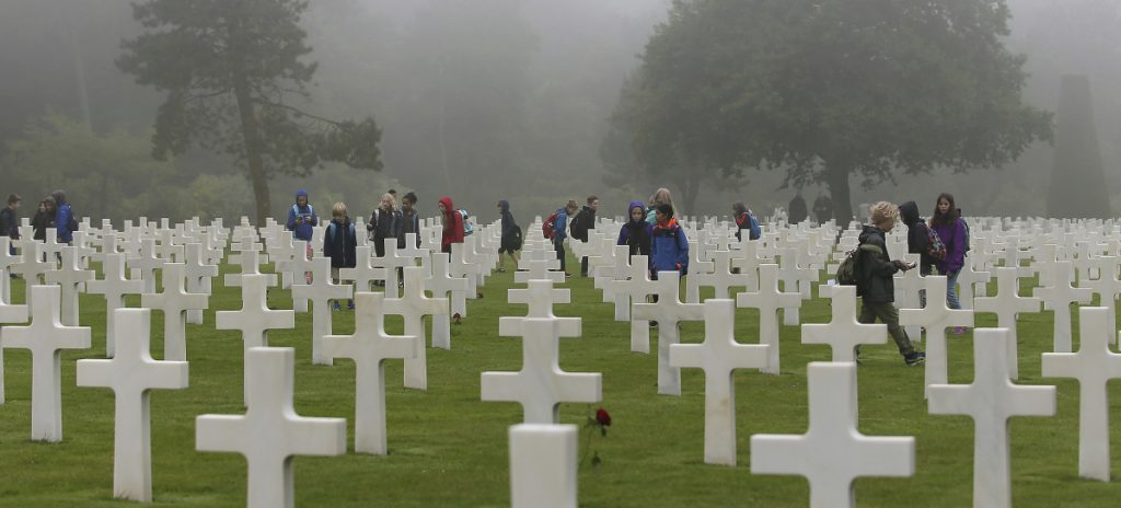 School children visit the American military cemetery in Colleville sur Mer, France, on the 74th anniversary of D-Day.