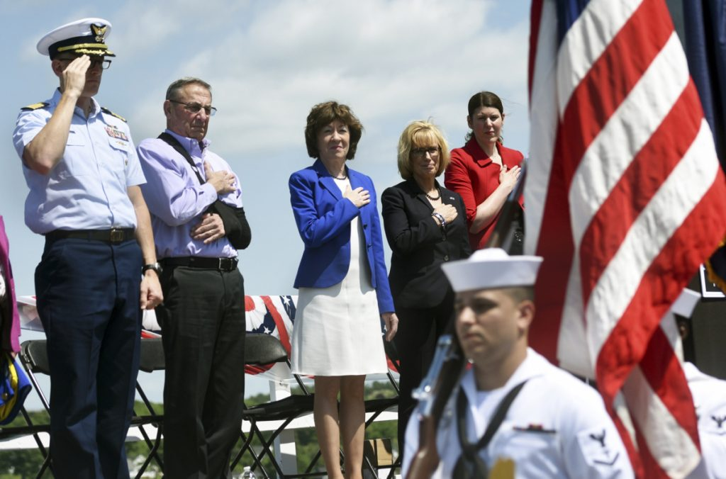Dignitaries put their hands over their hearts and salute as the colors are presented Friday during the Sarah Mildred Long Bridge Walk Celebration. From left are Coast Guard Capt. Brian LeFebvre, Maine Gov. Paul LePage, Maine Sen. Susan Collins, New Hampshire Sen. Maggie Hassan and New Hampshire Transportation Commissioner Victoria Sheehan.