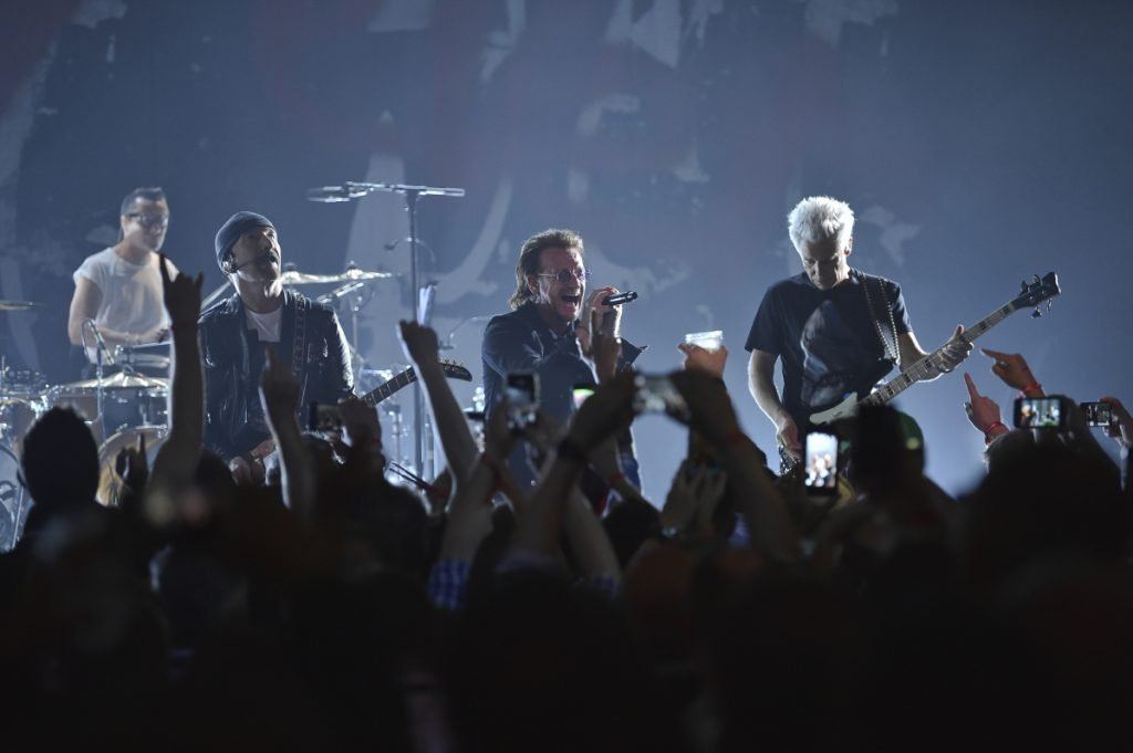 From left, Larry Mullen Jr., The Edge, Bono and Adam Clayton of U2 perform during a concert at the Apollo Theater on Monday night in New York.