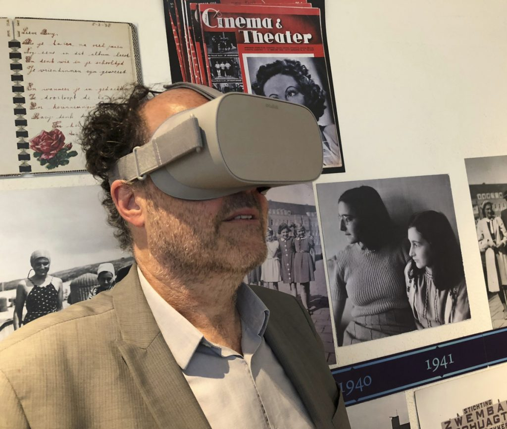 Ronald Leopold, executive director of the Anne Frank House, views a new virtual reality presentation Tuesday of the secret rooms where Anne Frank hid from the Nazis. Aleksandar Furtula Associated Press