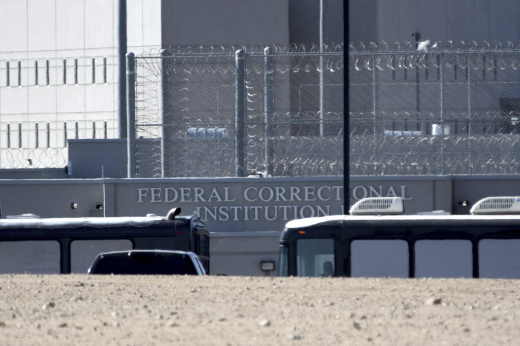 Homeland Security buses enter the Federal Correctional Institution in Victorville, Calif., on Friday. Parents arrested at the U.S.-Mexico border are being held at federal prisons while their children are filling up separate shelters. Unaccompanied children may soon find themselves in tent cities.