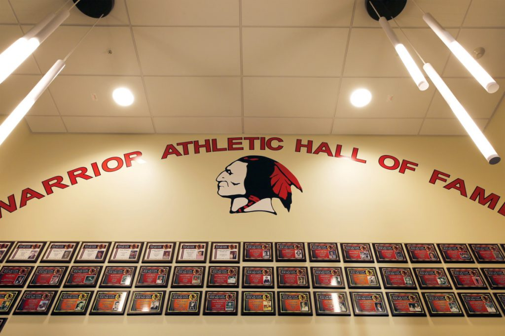The foyer to Wells High School's athletic center prominently displays the school's mascot. The Wells-Ogunquit school committee voted Wednesday to remove Native American imagery from all schools in the district. Staff photo by Ben McCanna/Staff Photographer